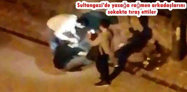 Sultangazi'de yasağa rağmen arkadaşlarını sokakta tıraş ettiler