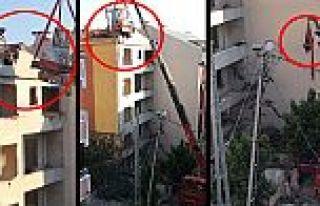 Arnavutköy'de vince bağlı iş makinasıyla tehlikeli...